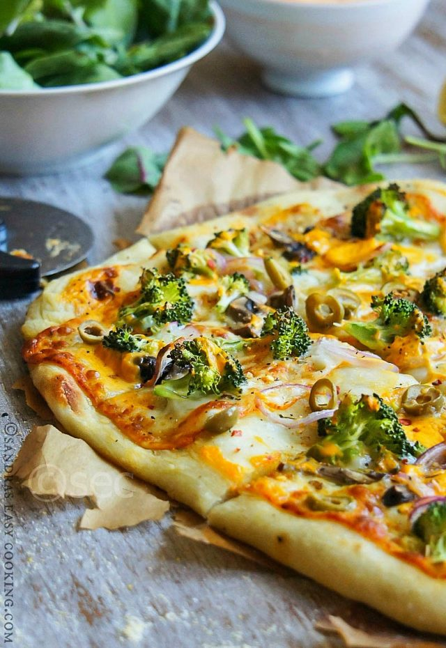Artisan Pizza is an ultimately amazing veggie pizza topped with Broccoli, red onion, mushrooms, olives and two kind of cheese. Lunch perfection!